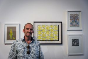 Open Canvas artist David Parkinson with his works at the Open Canvas Between the Lines exhibition opening. Picture: James Labagala