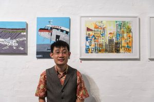 Open Canvas artist Perry Seau with his works at the Open Canvas Between the Lines exhibition launch. Picture: James Labagala