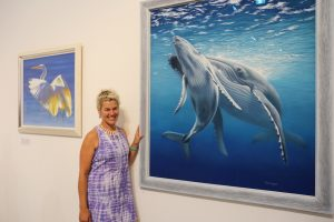 Open Canvas artist Renata Bruynzeel with her art at the Between the Lines exhibition opening. Picture: James Labagala